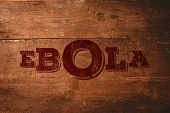 Red ebola text against overhead of wooden planks