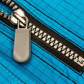 Close up zipper on a black background