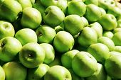 fresh raw lot of green apples on counter