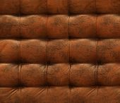 brown chesterfield upholstery.