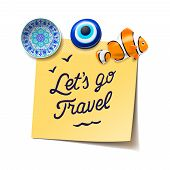 Travel and tourism concept. Lets go to the beach text on the post it notes, travel magnets, boarding