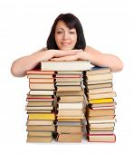 Young smiling woman with heap of books isolated