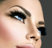 Постер, плакат: Beauty face makeup Make up Eyelashes extensions Perfect Make up closeup Foundation Cosmetic Eye