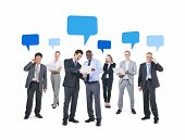 Group of Business People Using Technological Devices with Blank Speech Bubbles Above Them