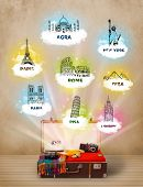 Tourist suitcase with famous landmarks around the world on grungy background
