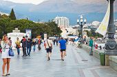 Tourists On Lenin Embankment In Yalta In Evening