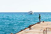 Fisherman On Pier In Black Sea