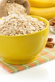 bowl of oat flake isolated on white background