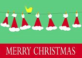 Santa claus hats on a clothesline with a yellow bird and merry christmas message.