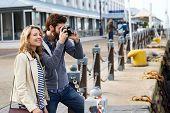 travel couple taking photos on holiday