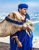 Camel driver on the mountain