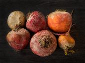 Beets In Different Colors On A Dark Background