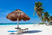 Tropical thatched umbrella on a beautiful Caribbean beach