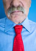 Mustache closeup (selective focus on tie)
