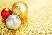Beautiful christmas balls on abstract glitter background close-up