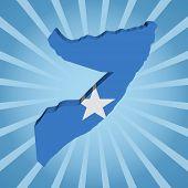 Somalia map flag on blue sunburst illustration