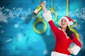 Woman smiling with christmas presents against blurred christmas background