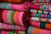 picture of alpaca  - alpaca colorful cotton and wool blankets at market - JPG