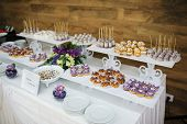 stock photo of buffet catering  - wedding dessert with delicious cakes and macaroons - JPG