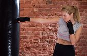 stock photo of punch  - View of girl training with punch bag - JPG