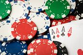 stock photo of poker hand  - four of a kind poker hand Aces and many chips