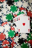 pic of poker hand  - four of a kind poker hand Aces and many chips - JPG