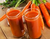 image of carrot  - glasses of carrot juice and fresh carrots on a wooden table - JPG