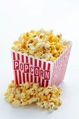 pic of popcorn  - A box of buttered popcorn isolated on white - JPG