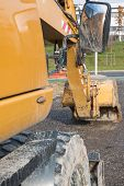 picture of power-shovel  - Muddy excavator shovel with rear - JPG