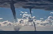 stock photo of waterspout  - Tornados over mediterranean sea in a sunny winter day
