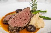 foto of mashed potatoes  - Slices of roasted beef with mashed potatoes mushroom caps asparagus garnished with rosemary - JPG