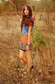 pic of auburn  - cute young woman with long auburn hair in the autumn forest - JPG