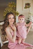 stock photo of pink eyes  - Young beautiful woman and mother - JPG