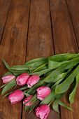 ������, ������: Bouquet of beautiful pink tulips on an old wooden floor