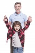 picture of grandfather  - Portrait of a healthy grandfather and his grandson are playing over the white background - JPG