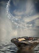 stock photo of rock star  - Fantasy landscape with rock and candle in the ocean - JPG
