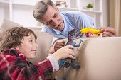 pic of grandpa  - A preschooler and his grandpa happily are playing with toy - JPG