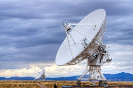 stock photo of antenna  - Radio antenna dishes of the Very Large Array radio telescope in New Mexico - JPG