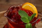 pic of jug  - Wine of Sangrija with an orange in a transparent jug on a wooden table - JPG