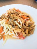 picture of green papaya salad  - Spicy green papaya salad Thai cuisine somtum - JPG