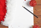 stock photo of letters to santa claus  - Letter to the Santa Claus composition of the copyspace blank sheet of paper next to multiple Christmas decorations over the wooden surface - JPG