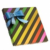 stock photo of gift wrapped  - Wrapped black gift box with a rainbow colored metallic bow and ribbon isolated over white background - JPG