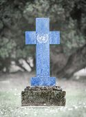 foto of cemetery  - Old weathered gravestone in the cemetery  - JPG