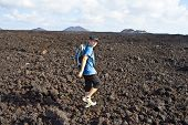 picture of volcanic  - boy on walking trail in volcanic area in Lanzarote - JPG