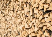 image of firewood  - Closeup of chopped firewood in a stack ready for burning - JPG
