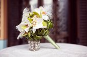 picture of arum lily  - Capture of Elegant lily bouquet on table  - JPG