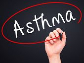 stock photo of asthma  - Man Hand writing Asthma with black marker on visual screen - JPG