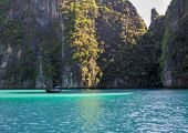 stock photo of phi phi  - Famous Phi phi island lagoon with a long tail boat - JPG