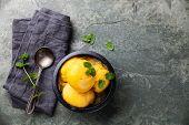 foto of mint leaf  - Mango ice cream sorbet with mint leaves on stone slate background - JPG
