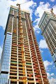 foto of skyscrapers  - Skyscraper Building under construction in summer day - JPG